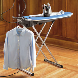 """Frontgate - Euroflex Advanced Ironing System - Heated aluminum surface with dual vacuum and air blowing function. Stainless steel 30 oz. boiler produces no-water steam. Durable Teflon coated iron plate suitable for any fabric. Multi-position adjustable height. Compact design, only 5-1/2"""" thick when closed. Ironing can be a time-consuming, tedious process as you work relentlessly to tame a wrinkled garment, only to find pressed in crinkles or pocket marks just when you think you've finished. How do professionals achieve sharp lines and crisp finishes so efficiently? Their trade secret is active ironing boards, like the Euroflex IB40 Monster Steam, with a dual suction and air-blowing system. These boards are equipped with powerful boilers, generating high-quality steam that smoothes out any fabric with ease. When the blowing mode is active, it puffs the garment off the board and allows it to be neatly ironed without the heavy-handed pressing that can leave behind unsightly lines. The suction function speeds up the process of ironing heavier fabrics by keeping them firmly in place and pulling the steam through multiple layers at a time. Additionally the Euroflex board is is heated to dry up any residual moisture so your clothes remain completely dry and refreshed. . . . . . 42"""" x 17"""" ironing surface."""