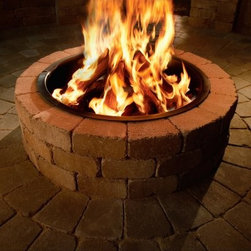 Necessories Compact Fire Ring - Please note: This item does not include to-the-door delivery. This item includes curbside delivery.Complete your backyard or patio with the Necessories Compact Fire Ring. It's made of durable stone to stand up to the elements. This fire ring features a heavy-gauge steel insert that protects the block. A DIY beauty, t his fire ring assembles in an afternoon and comes with all necessary materials to make your job easier. You get pre-cut concrete block sized to fit, steel reinforcements, Super-Stik adhesive, gloves, and easy-to-read instructions. It's a available in a variety of color options to make a perfect match to your outdoor living space.Note: Review any building restrictions or construction permit requirements before installation of an outdoor fireplace. Contact your local zoning commission/homeowners association for details.About NecessoriesNecessories is a third generation family business based in Rochester, Minnesota. Necessories has a solid foundation in mortarless concrete manufacturing and construction that dates back to 1914. They are recognized as an innovator of attractive, high-quality landscape construction materials. Necessories is a collection of Outdoor Living Kits. This is a unique line of outdoor living kits that make hardscaping affordable and easy. Each kit comes packaged with all you need to build including pre-cut concrete block, Super-Stik adhesive, and easy to read course by course assembly instructions. These outdoor living kits require no cutting, no guessing, no hassles -- no problem.