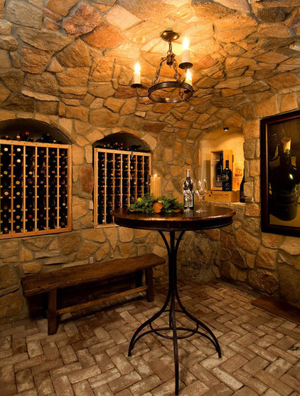 mediterranean wine cellar by Riverland Homes Inc