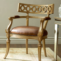 "John-Richard Collection - ""Tuscan"" Chair - An eye-catching style, the ""Tuscan"" Chair is bold in design.  It will make a beautiful and dramatic statement wherever you choose to use it. Brown leather seat is accented with nailhead trim and the acacia wood frame has a creamy gold finish. 25""W x 21""D x 36T"