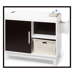 Maclaren Moderne Changer - This compact yet multi-function changing table with bring streamlined chic to a nursery. White laminate with ebony veneers for dimension, this piece has a side drawer as well as a flip top so this can become a modern cabinet worthy of any room in the house.