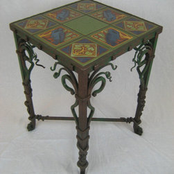 Wrought iron and tile tables - Organic forged wrought iron table designed and executed by Bushere & Son Iron Studio Inc.  with high quality hand painted raven tiles.  Finely detailed from top to bottom.  Finished in our very own  green and rust brown patina.  Made in the USA.