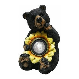 Alpine Corporation - Black Bear with Solar Sunflower Garden Statue - These cute black bear statuaries will add character to your garden, patio or home. Simply place in your garden and let it charge in the day and watch as it illuminates at night bringing life into your garden.