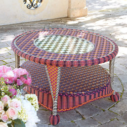 """MacKenzie-Childs - Sunset Outdoor Coffee Table - MULTI COLORS - MacKenzie-ChildsSunset Outdoor Coffee TableDetailsHandcrafted of handwoven resin wicker with iron frame and 12-gauge enameled steel plate.Outdoor safe; store away from harsh elements.Due to the nature of handcrafting tables may vary.39""""W x 33""""D x 20""""T.Imported.Boxed weight approximately 60 lbs. Please note that this item may require additional delivery and processing charges.Designer About MacKenzie-Childs:Established in 1983 MacKenzie-Childs combines vibrant colors and patterns to create a whimsical collection of tableware furniture and decorative accessories that epitomize """"tradition with a twist."""" The company's designers draw inspiration from the pastoral setting of their studios located on a 65-acre former dairy farm in Aurora New York."""