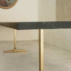 BDDW Bronze Trestle Table - I love the stark contrast between these glam Bravura Modern-ish trestles and the dark wood one can imagine a lumberjack cutting down in the forest.