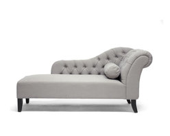 Wholesale Interiors - Aphrodite Tufted Putty Gray Linen Modern Chaise Lounge - Peace of mind is not hard to find when you can retreat to the comfort of the Aphrodite Modern Chaise Lounge. This queenly design does not skimp on details: a scrollback, plentiful button tufting, and a bolster pillow are featured. Construction is done in China with a wooden frame, foam cushioning, and neutral putty gray linen upholstery that lends itself well to a variety of decor. Black wooden legs with non-marking feet finish it off. Some assembly is required for this designer chaise lounge, which must only be spot cleaned.
