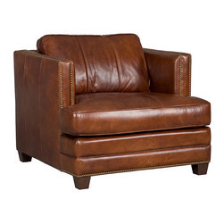 Frontgate - Ludlow Chair - Top-grain leather with a medium-brown Sanctuary Haven finish. Comfortable loose box-edge cushions have self-welting, luxurious premier down filling, and a durable foam core. Substantial track arms continue at the same height as the sofa back. Mahogany block feet for a transitional look. Made of kiln-dried, laminated, and select hardwoods, precision-machined for a fluid and consistent shape. In our Ludlow Chair, relaxed, thick, loose cushions are set within the structure of tall, square track arms, creating a contemporary yet comfortable cubic feel. The transitional design is tailored with details like a hand-hammered brass nailhead trim, vertical welting on the outside arms, and sophisticated paneled leather on the back cushions. . . . . . High-quality 15-ply engineered frame offers dimensional stability and prevents warping. Computer-gauged webbed seating system for consistent support from seat to seat. Pattern-cut urethane foam interior padded with felt polyester fibers for ultimate comfort, loft, and recovery. Highly resilient, high-density foam core seat cushion is wrapped with virgin polyester fibers and covered with a special ticking for lasting luxurious comfort and a pleasing crown appearance. The Ludlow Chair, with a Sanctuary Haven and mahogany finish, ships in 14 days. Frame has a lifetime structural warranty; foam cores have a lifetime warranty not to lose their compression or crown. Coordinates with other items from our Ludlow collection.