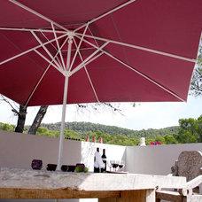 Mediterranean Outdoor Umbrellas by CARAVITA USA Inc - Exclusive Sunshades
