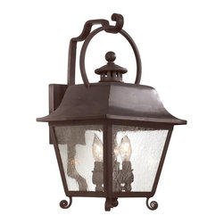 Troy Lighting - Troy Lighting Bristol 60W Candelabra Traditional Outdoor Wall Sconce - diffuses the light evenly and illuminates your home with a soothing glow with this Troy Lighting Bristol 60W Candelabra Traditional Outdooruly Wall Sconce. It has a hand-forged iron frame in a natural bronze finish with panels of clear seeded glass. It's an attractive and charming, three-light piece that's sure to light up your home in style.
