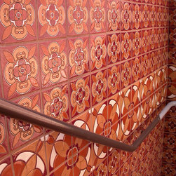 Fireclay Tile - Cuerda Seca - This Cuerda Seca install was featured on the wall of a stair case. Cuerda Seca's are fully customizable, so this client elected to go with a tone on tone color pallet in a variety of Cuerda Seca designs.
