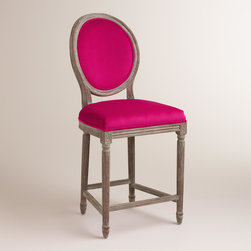 World Market - Fuchsia Paige Counter Stool - A classic with a round back silhouette, our Fuchsia Paige Counter Stool is crafted of American white oak with carved details and a distressed finish. Pull this exclusive velvet upholstered stool up to the bar or kitchen for a stylish seating update.