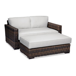 Thos. Baker - Outdoor Wicker Loveseat Lounger | Hampton Java Collection - Our most popular over-sized wicker collection is now available in a rich java color weave. Premium, dyed-through resin wicker with an extra large diameter profile and a rich variegated rustic finish. Powder-coated aluminum sub-frame and brushed aluminum feet.Plush Sunbrella cushion sets included where applicable. Choose quick ship in khaki with cocoa piping, stone green or choose from our made-to-order fabric options.Made-to-order cushion sales are final and ship in 2-3 weeks.