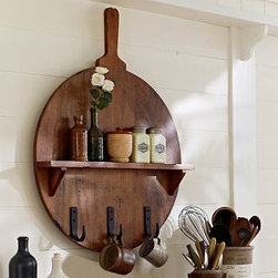"Cuisine Wall-Mount Wood Pizza Board Shelf With Metal Hooks - The classic breadboard is stylishly reinvented as a wall-mounted spice shelf with utensil hooks. 24.25"" wide x 3.5"" deep x 32"" high Made of mango wood. Three iron hooks. Catalog / Internet Only."