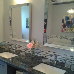 Girls' Bathroom - Additional bling is provided in this girls' bathroom with mirror-framed mirrors over custom-designed double sink vanity, with blue granite countertop, glass & marble mosaic backsplash.