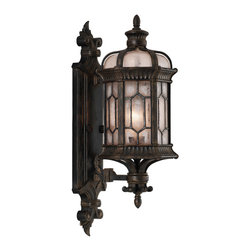 Fine Art Lamps - Devonshire Outdoor Wall Mount, 413781ST - With its picturesque forged bronze detailing and vintage-looking seedy glass panes, this outdoor lantern transports you to another era. The textured glass gives you a misty, diffused light that softly calls you home.