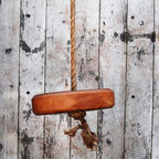 Rustic Tree Swing - This rustic tree swing is sure to take you back to a simpler time. Made of reclaimed old-growth pine and natural fiber rope strong enough to withstand 695 pounds of tension, it's ready to hang right away and sturdy enough for years of use. You can get it for the kids, but we bet you won't be able to resist a ride!