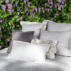 The Cortland Gray Duvet Set - Beautifully tailored with folds and pleats, the Cortland exudes the utmost elegance in the master bedroom.  The Cortland Duvet was designed with Crane & Canopy's bedding accessory line, the Floral Belles, for those who want that extra frill and dash of feminine in the bedroom.