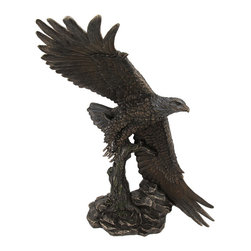 Bronze Finished Soaring Eagle Statue Hand Painted Accents - This beautiful cold cast resin soaring eagle statue is quite lifelike. The statue measures 14 3/8 inches tall, 14 inches long and 12 inches wide. It has a wonderful bronzed finish that gives it the look of metal, and has hand-painted accents to show off the incredible detail. It`s a must have for nature lovers.