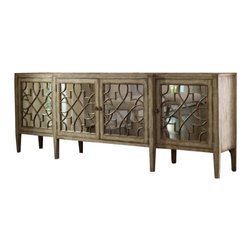 Hooker Furniture - Four-Door Mirrored Console, Surf, Visage - This grand buffet offers service with style. The weather-finished wood cabinet features a lacy fretwork of wood over antiqued mirror doors. Use it for dishes, glassware and table linens, or add it to your entry hall for extra savvy storage.
