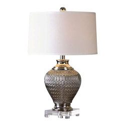 Uttermost Osgar Metallic Silver Lamp - Metallic silver textured glass accented with polished nickel plated details and a crystal foot. Metallic silver textured glass accented with polished nickel plated details and a crystal foot. The slightly tapered round hardback shade is a crisp white linen fabric.