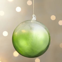 Green Global Dip Dyed Ball Ornament - Translucent glass orbs and teardrops are hand-dipped in jewel tones for an ethereal, luxe look.
