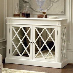 Ballard Designs - Biarritz Mirrored Console - 2 adjustable shelves for generous storage. Notched corner top with stepped edge. Fluted pilasters crowned in hand carved florettes. Crafted of poplar & birch veneers. Antique white finish. Mirrored door panels with diamond-shaped mullions and classically inspired details make this refined mirrored Console a standout in the living room, dining room or bath. Sides are mirrored as well, so you can enjoy the look from every approach. Biarritz Mirrored Console features:. . . Crafted of poplar & birch veneers.  . Antiqued brass metal hardware.