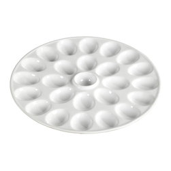 Tabletops Unlimited - 13.25 in. Denmark Deviled Egg Platter - Dishwasher Safe.  Microwave Safe.  Chip Resistant. Material: Porcelain. 13.375 in. L x 1.78 in. H x 13.78 in. W x (5.32 lbs.)Denmark's distinct deviled egg platter also promotes elegant and efficient entertaining. The pure white porcelain platter's 24 perfectly formed pockets snugly hold a dozen eggs in place, and the sauce well in the center holds your garnish for more serving efficiency and an attractive presentation.
