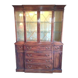 Pre-owned Vintage Breakfront by Bernhardt - Beautiful vintage cabinet with pull down drawer turns into a writing surface, glass shelves, lighting in working condition.  The inside has a custom painted finish. Gilded fretwork on glass doors give just enough elegance.