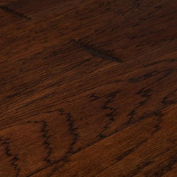 "Jasper - Jasper Engineered Hardwood - Harbors Hickory Distressed Collection - [25.0 sq ft/box] - Santa Fe / Hickory / 6"" -    North America's toughest domestic wood meets long-wearing engineering science, and comes out with a beautiful natural appeal in the Jasper Engineered Distressed Hickory Collection. Available in natural creamy hickory tones as well as a rich, warm, medium brown, selections in the Distressed Hickory Collection will add dimension to your space while giving you some peace of mind with its 25-year residential warranty.    Where style and smarts connect    Designed by nature, enhanced by engineering, the Jasper Distressed Hickory Collection comes with a tough 25-year finish and structural warranty. It's the toughest wood grown in America, and made tougher by engineering so as to resist fading, scratches, dents, and even flames, because we know your floor will be put to the test time and time again in years to come.    Long-wearing beauty with a fast, easy install    The tongue-and-groove system in the Jasper Engineered Hickory Distressed Collection means a quick, flexible installation where you can nail it down, glue it, or even float it over bare concrete, thanks to a core that defends against moisture.    A thicker wear layer means you can refinish this flooring years down the line if you ever choose to do so, but until then you'll enjoy great looks bolstered by a craftsman-style chiselled edging, brushed distressed finish that calls to mind the look of yesteryear's hardwood floors while offering the strength of modern engineering, including a hardy urethane and aluminum oxide finish.    Built tough, with a hard warranty, at an easy price    BuildDirect was built on the promise of getting you great durable products at unbeatable prices, and that's why this is yet another winning product we're proud to stand behind.     With this Engineered Jasper Distressed Hickory Collection, we've worked with our manufacturing partners to ensure you can res"