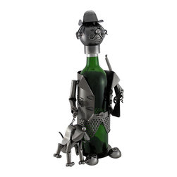 Hunter With Rifle and Hunting Dog Metal Art Wine Bottle Display - Give your wine bottles some personality! This unique piece of home decor would make a great housewarming gift. The remarkable figure is formed in the likeness of a hunter holding a rifle in one hand and the leash of his hound in the other. Bottles stand inside the body and are topped with the head piece, turning the neck of the bottle into that of the hunter. The head piece is attached to the body by a chain to avoid misplacement. Crafted from metal, the display measures 14 1/2 inches tall, 7 inches wide, and 5 1/2 inches deep. It makes a great conversation piece, and is sure to be admired. NOTE: All measurements include the wine bottle, but the bottle is not included with purchase.