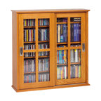 Leslie Dame - Mission Style Sliding Glass Door Wall Mounted - Handcrafted Solid Oak Veneer Mission Style Wall Hanging Multimedia Storage Cabinet has that rare combination of classic design. High quality construction. This beautiful furniture quality cabinet will compliment any decor while providing the consumer the versatility of holding CD's, DVD's, VHS Videocassettes or Game Cartridges. Holds 350 CDs, 144 DVDs. Oak finish. 31.875 in. W x 9.5 in. D x 32.375 in. H