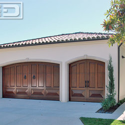 Solid Wood Mediterranean Garage Doors Custom Made by Hand - Corona del Mar, CA - These custom Mediterranean Garage Doors are a perfect example of our authentically designed and handcrafted garage doors and gates found throughout Orange County, CA. Because of our rich design and top quality we also are highly acclaimed in other states and abroad where we ship constantly to clients who are discerning and want something uniquely designed for their particular home and/or project.