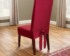 Sure Fit - Sure Fit Cotton Duck Dining Room Chair Cover - 37894 - Shop for Chair and Slip Covers from Hayneedle.com! The Straight Skirt with Ties cover is a one-piece furniture cover with patented seat elastic four sets of ties and inner pleats to minimize tucking. It features one set of ties on each corner to ensure a secure and attractive fit. About Sure FitSurefit Inc. is widely known for its attractive quality furniture covers slipcovers and decorative accessories. The success of their ready-made furniture slipcovers and accessories is based on extensive experience providing cost-effective decorative solutions made to fit in a broad range of styles to meet the needs of all customers. Sure Fit's furniture slipcover product line includes slipcovers for sofas loveseats chairs oversized chairs wing chairs dining room chairs recliners ottomans and folding chairs as well as furniture and pet throws. Sure Fit also sells coordinating decorative pillows. Sure Fit is dedicated to quality product with rigorous durability and performance standards that are second to none. Many patterns feature dual-action Scotchgard Protector to repel and release stains. Home of the Ten Minute Makeover Sure Fit provides an attractive and affordable solution for consumers who need to protect furniture from children pets and general wear or want to quickly and cost-effectively upgrade their furniture and enhance the appearance of any room.Please note this product does not ship to Pennsylvania.