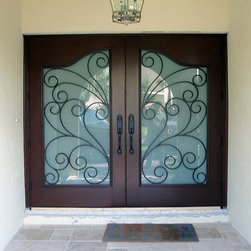 Solid Wood Iron Double Doors - Solid wood wrought iron double doors with satin sand blasted safety glass and decorative wrought iron grills that are operable to allow cleaning of the glass more functionable. The glass panels are custom curved shaped. Doors come in any sizes, specs and designs!