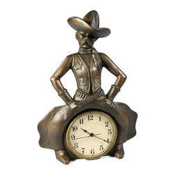 OK Casting - Bowlegged Cowboy Desktop Clock - 0784-B - Shop for Clocks from Hayneedle.com! Rough tough and totally ... cute the Bowlegged Cowboy Desktop Clock will give your desktop a wink of wild-west whimsy. This decorative desktop clock features an iconic Wild West sheriff proudly sitting atop the hands of time. He's lean mean and (dare we let the word out) cute as can be. Crafted of hand-cast and hand-finished resin this is one terribly charming timepiece.About OK Casting LLCSince 1993 OK Casting has been serving the home gift and private artist market with memorable home decorative accessories. Hand-made and manufactured in the United States OK Casting's products are created from the finest and most durable resins. Whether for their lamps wall decor bookends or statutes OK Casting is known for exquisite craftsmanship and attention to detail. Inspired by lodge wildlife and equine artwork each piece radiates beauty and quality for your home cabin or lodge decor.