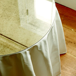 "Ballard Designs - Antiqued Mirror Table Topper -30 inch Diam. - Hand made. 1/4"" thick antiqued mirror. Pencil polished edge""2"". When the occasion needs a dressy touch, add our mirrored round table toppers for extra shimmer. Designed to coordinate with our Terrific Tables and Round Party Table, they protect your tablecloth from spills, while providing a smooth surface for place settings and serving. Antiqued Mirror Table Topper features: .  . ."