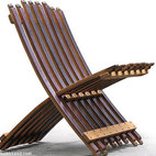 Folding Wine Barrel Chair - Made from salvaged oak wine barrels, this steamer deck chair is too good. I would love to have a pair for a wrap-around porch.
