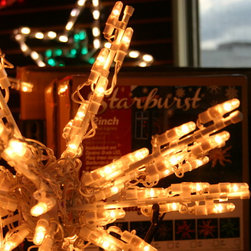 """Holidynamics - Christmas Product - Starburst come in 12"""", 18"""" and 24"""" sizes, each starburst have 50 or 100 lights on it.  Starburst easily fold down for storage and have a hanging washer on them to hange up easier."""