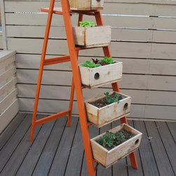 Wooden Garden Accesories - Creations like this repurposed ladder provide a back-saving gardening method, while keeping your strawberries away from ground-dwelling earwigs.