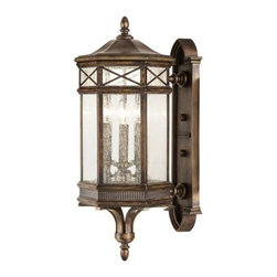 837481ST Outdoor Wall Mount Holland Park - Classical Greek inspired hexagonal wall mount in a warm antique bronze finish with hand cast seedy glass and romantic candles.