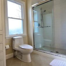 Transitional Bathroom by dRemodeling