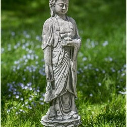 Campania International Standing Lotus Buddha Garden Statue - Create serenity in your meditation garden by placing the Campania International Standing Lotus Buddha Garden Statue where you will see it every day. This Buddha statue is beautifully carved, from serene expression to lotus base and is the perfect size to make a statement in any setting. It's durable enough to withstand the elements and is handcrafted of weather-resistant cast stone concrete that undergoes an intensive 15-step process to make each detail stand out. This standing statue of Buddha is available in a variety of finish options and comes unsealed so it will naturally develop an antique patina as it gracefully goes through each season.About Campania InternationalEstablished in 1984, Campania International's reputation has been built on quality original products and service. Originally selling terra cotta planters, Campania soon began to research and develop the design and manufacture of cast stone garden planters and ornaments. Campania is also an importer and wholesaler of garden products, including polyethylene, terra cotta, glazed pottery, cast iron, and fiberglass planters as well as classic garden structures, fountains, and cast resin statuary.Campania Cast Stone: The ProcessThe creation of Campania's cast stone pieces begins and ends by hand. From the creation of an original design, making of a mold, pouring the cast stone, application of the patina to the final packing of an order, the process is both technical and artistic. As many as 30 pairs of hands are involved in the creation of each Campania piece in a labor intensive 15 step process.The process begins either with the creation of an original copyrighted design by Campania's artisans or an antique original. Antique originals will often require some restoration work, which is also done in-house by expert craftsmen. Campania's mold making department will then begin a multi-step process to create a production mold which will properly replicate the detail and texture of the original piece. Depending on its size and complexity, a mold can take as long as three months to complete. Campania creates in excess of 700 molds per year.After a mold is completed, it is moved to the production area where a team individually hand pours the liquid cast stone mixture into the mold and employs special techniques to remove air bubbles. Campania carefully monitors the PSI of every piece. PSI (pounds per square inch) measures the strength of every piece to ensure durability. The PSI of Campania pieces is currently engineered at approximately 7500 for optimum strength. Each piece is air-dried and then de-molded by hand. After an internal quality check, pieces are sent to a finishing department where seams are ground and any air holes caused by the pouring process are filled and smoothed. Pieces are then placed on a pallet for stocking in the warehouse.All Campania pieces are produced and stocked in natural cast stone. When a customer's order is placed, pieces are pulled and unless a piece is requested in natural cast stone, it is finished in a unique patinas. All patinas are applied by hand in a multi-step process; some patinas require three separate color applications. A finisher's skill in applying the patina and wiping away any excess to highlight detail requires not only technical skill, but also true artistic sensibility. Every Campania piece becomes a unique and original work of garden art as a result.After the patina is dry, the piece is then quality inspected. All pieces of a customer's order are batched and checked for completeness. A two-person packing team will then pack the order by hand into gaylord boxes on pallets. The packing material used is excelsior, a natural wood product that has no chemical additives and may be recycled as display material, repacking customer orders, mulch,or even bedding for animals. This exhaustive process ensures that Campania will remain a popular and beloved choice when it comes to garden decor.Please note this product does not ship to Pennsylvania.