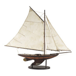 """Thos. Baker - yacht ironsides - The charm is in the details like a hull built-up with alternating planks of dark and light wood. A weathered and aged appearance could easily date to the be from the 1930s. All wood, walnut finished, brass antique hardware and traditional tea-stained sails. A full 34"""" tall (plus stand height) with cast-iron original issue keel weight.�"""