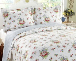 Laura Ashley Roseland Floral 3-Piece Cotton Reversible Quilt Set - Pretty pops of color abound in bouquets of classic florals on the Laura Ashley Roseland Floral 3-Piece Cotton Reversible Quilt Set. Refresh your bedroom in one step with this beautiful, room-brightening bedding set. Each set includes the quilt and 1-2 matching shams to complete the look. Constructed of 100% cotton, this set is not only super comfortable and durable, it's also conveniently machine-washable. Available in your choice of size to best suit your bedding needs.Quilt Dimensions:Twin: 68 x 88 in.Full/Queen: 90 x 90 in.King: 104 x 96 in.Sham Dimensions:Twin: 20 x 26 in.Full/Queen: 20 x 26 in.King: 20 x 36 in.