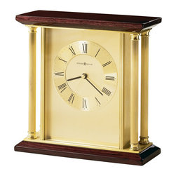 Howard Miller - Howard Miller Carlton Table Top Clock - Howard Miller - Mantel / Table Clocks - 645391 - This contemporary table top clock has a time-tested appeal and offers to bring a brightness to your desk or mantel. Distinguished by its reeded brass columns rosewood top and base and brushed brass dial with circular spun numeral ring the Carlton has a suggestion of sophistication to it. A protective felt bottom and reliable quartz movement operation complete the look and appeal of the Carlton Table Top Clock.