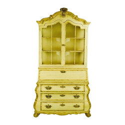 Pre-owned Painted Dorothy Draper Bookcase Cabinet with Desk - A fabulous storage piece with color and personality! Designed by Dorothy Draper for Henredon, it's a pop of drama. Gorgeously made of solid wood.     The base is Dutch style bombe with three wide drawers - perfect for keeping kid's art or gift wrap. The middle features a drop-down secretaire unit with space for all your chargers, cables, and miscellaneous paperwork that you'd like to stash behind its closed lid. Three bookshelves top it off, with two arch top doors that have brass mesh inserts. All in Draper's flamboyant flowing Hollywood Regency style.    This piece is in very good vintage condition. A part of the drawer handle on the lower right was missing, but has been replaced with a similar handle that blends in. The original backplate is there, so this fix is not eye-catching. The replaced handle is why we label the condition good rather than excellent, but all other elements are in great shape.  Paint on this piece is original - yellow with bronzy accents.    Have some fun with this sunny cabinet!