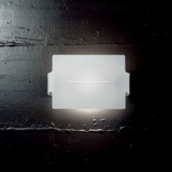 "Sillux - Sillux Ibis wall sconce LP 1008/24 - The Ibis wall sconce has been designed by Arcadia for Light for Sillux. This wall sconce comes with a curved glass lampshade which is available in white. The frame is Lacquered white aluminum.  Product description:  The Ibis wall sconce has been designed by Arcadia for Light for Sillux. This wall sconce comes with a curved glass lampshade which is available in white. The frame is Lacquered white aluminum. Details:                         Manufacturer:             Sillux                            Design:                         Arcadia for light                                         Made in:            Italy                            Dimensions:                         Height: 9 1/2"" (24 cm) X Length: 6 1/4"" (16 cm) X Projection: 2 3/4"" (7 cm)                                         Light bulb:                          1x 150W R7s halogen                             Material             aluminum, glass"