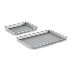 """Calphalon Jelly Roll Brownie Pan Combo Set - This convenient set includes two of our most popular pans  and is ideal for making a wide variety of baked goods  including cookies  brownies  cakes and more. Calphalon Nonstick Bakeware has interlocking nonstick layers to deliver high performance release. In fact  it releases up to 2 times better than Calphalon Classic Bakeware. Now  even the stickiest baked goods can be removed cleanly for beautiful results and easy cleanup.  Product Features      Dishwasher safe   Full Lifetime Warranty   Heavy-gauge steel core heats evenly   Interlocking nonstick layers for high-performance release   Releases up to 2X better than Calphalon Classic Bakeware     Set Includes      12""""x17"""" baking sheet   9""""x13"""" brownie pan"""