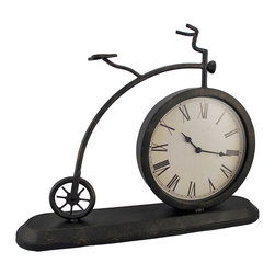 Antique Metal Bicycle Mantel or Table Clock - Add an old fashioned accent to your home decor with this antique bicycle mantel clock. Made of metal, it measures 15 inches tall, 19 inches long, 4 1/4 inches wide, and has an 8 1/4 inch diameter glass clock face. The clock features quartz movement and runs on 1 AA battery (not included). This piece makes a great gift for your favorite cycling enthusiast, and is sure to be admired.
