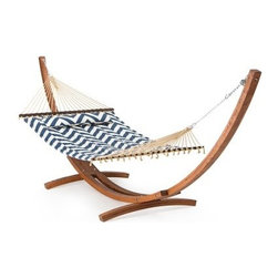 Island Bay 13 ft. Harbor and Cream Chevron Stripe Quilted Hammock with Wood Arc - Built for two, the Island Bay 13 ft. Harbor and Cream Chevron Stripe Quilted Hammock with Wood Arc Stand makes for the perfect retreat away from the stress of your day. Featuring a fun and stylish combination of blue and white in a chevron design, this beautiful hammock is a whimsical addition to any yard. A wide, sturdy spreader bar keeps the hammock flat and comfy; perfect for taking a nap or reading a long book. Button on the included button-on pillow for an extra level of comfort that will make it hard to get up again. The gorgeous Algoma 15-foot Russian Pine Wood Arc Hammock Stand is the perfect complement to this comfortable hammock. Crafted from beautiful Russian pine wood, this stand artfully suspends the hammock and allows for plenty of swing. The sculptural arc design adds elegance and sophistication to your yard's landscape, making for a picturesque lounging area. Sealed for protection from the elements, this stand and hammock set will be a favorite hangout for the entire family. The dimensions of the bed itself are 6 feet 5 inches in length and 4 feet 6 inches in width. Overall, this hammock stretches a total of 11 feet 5 inches and requires a hanging distance of at least 13 feet with a 16-foot maximum. The maximum weight capacity is 450 pounds. Hanging hardware is included. Additional Features Stand crafted from beautiful Russian pine wood Sculptural and sturdy arc design Assembly required Overall hammock length: 11 ft. 5 in. Bed dimensions: 6 ft. 5 in. L x 4 ft. 6 in. W Stand dimensions: 15L x 4W x 4H feet About Island Bay HammocksIsland Bay brings you well-designed, authentic hammocks and accessories from around the world. From the East Coast to the West Indies, the hammock is recognized as the ultimate getaway, so we've dedicated ourselves to getting it right. You'll find eye-catching colors and patterns, comfortable outdoor designs, and heavy-duty stands designed to keep you swinging peacefully. It's your world ... relax in the real thing.